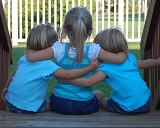Sally Jones of Canfield caught this moment in August as her daughters, Allison, 3; Samantha, 4; and Lindsay, 3, sat outdoors.
