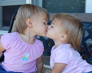 """Sally Jones of Canfield took this shot of her twin daughters """"smooching"""" in May, 2007. They're Allison and Lindsay, both 2."""