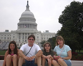 Here is a family picture showing togetherness.  It is from August 7, 2008 in front of the Capital in Washington, D.C.  Pictured are Liana (age 10), Eric, Sean (age 12) and Melissa Pregi.  Our first visit to Washington D.C. during a very historic election year.