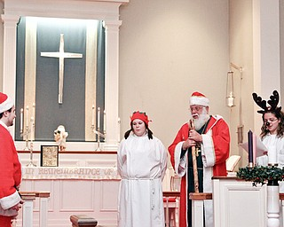 """ST. NICHOLAS FESTIVAL: Participants in """"A Festival Eucharist"""" at St. James Church donned festive costumes for the St. Nicholas Day Festival. The event was Saturday. They are, from left, Zeke Coughlin, Jamie Vanden Bosch, William Dick and Lydia Scheel. The festival Eucharist celebrates the life of Nicholas, bishop of Myra and patron saint of children."""