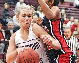 MOVING FORWARD: Boardman's Kayleigh Lipke pushes by Anokha Padubidri of Canfield during the first-half action of Saturday's game in Boardman. The Spartans defeated the Cardinals, 51-42.