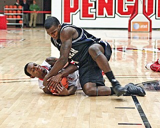 FLOORED: De'Andre Mays of Youngstown State and Butler's Shelvin Mack battle for the ball during Saturday's game at Beeghly Center. The Penguins fell 79-71 to their Horizon League rival.