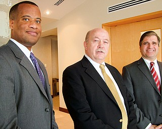 EXPANSION INCENTIVE: Posing in Columbus on Monday after a talk are, from left, Youngstown Mayor Jay Williams; Roger Lindgren, president of manufacturer V&M Star Steel; and GIrard Mayor James Melfi. Youngstown and Girard have offered incentives to V&M Star, which borders the cities, if it chooses to expand in that area.
