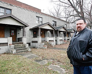 James London outside The empty six plex at 1002 -1006 Parkview in Youngstown on the demolition list part of Mark King Properties