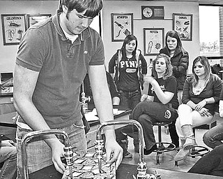 <p>Special to The Vindicator</p> <p>IT'S A WRAP: Students from area high schools, who will be volunteer gift-wrappers during a Jewish Community Center gift-wrap fundraiser on Dec. 24 at the Southern Park Mall, watch as Brendan Paull of Boardman High School demonstrates the gift-wrapping technique he learned during the past two weeks in preparation for the fundraiser.</p>