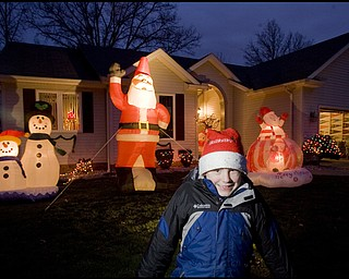 12.15.2008 Michael Wolfgang, age 9, impressed his family by putting up all the outdoor Christmas decorations surrounding his Girard home. Geoffrey Hauschild