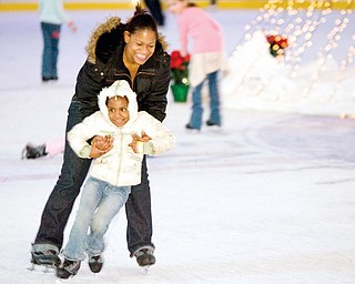 Latia Ballard, of Austintown, helps Tierni Ballard, age 4, ice skate for the first time during Holiday Ice Skating at Chevy Centre.