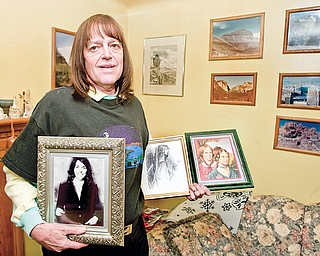 Phillip Lyle displays images of his musical and literary inspirations,  (left-right) Karen Carpenter, in addition to Anne, Emily, and Charlotte Brontë, in his Youngstown home. Lyle recently became a member of Mensa.
