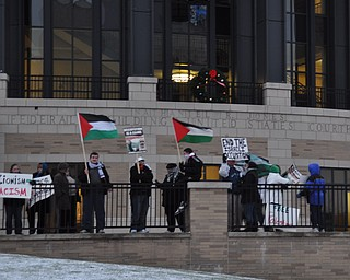 Members of the Arab-American Community Center of Greater Youngstown protest in downtown Youngstown just before the start of First Night Youngstown 2009