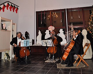 Father Vit and Friends play cello as part of First Night Youngstown 2009