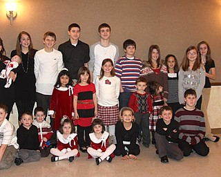 A photograph of the younger generation of the Menichini Family from Lowellville celebrating at their annual Christmas Eve Party 2008 at the Lowellville Mt. Carmel Hall.
