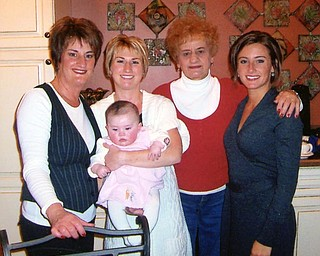For Debbie Walcott of Youngstown, joy is having extended family together for Christmas Eve. Lee Houser of Boardman is surrounded by her daughter, Walcott, and two granddaughters, Jessica Krauser of Columbus and Tricia Lenhart of Boardman, along with great granddaughter Samantha Rae.
