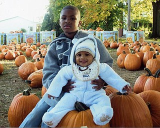 Rukaiyah Gillum of Niles sent this shot of Quincy, 6, and Myles, 5 months, at Whitehouse farm. Myles, in particular, seems delighted.