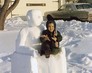 "Eugene Magalotti of Hubbard sent a shot of his grandson, James Victor Frank, on the lap of a Lincoln Memorial statue that he had fun building out of snow. Magalotti allows as how this shot was taken ""a few years back."""