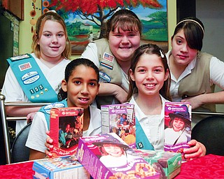 Girl Scouts posing with cookies front l-r Rachael Herns, 10, and Wendy Ford, 11. Back l-r Shelby McIntroy, 12, Breanna Armeni, 13 and Crystal  Munoz, 13  They are members of troops 155 and 81 of Campbell.