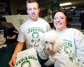 Sherry Trolio-DiVito, owner of Trolio Tshirts in Poland her grandson Jerry Beeson, an employee at the shop, and their dog Noodles sport Welcome Home Jimbo shirts they are selling.