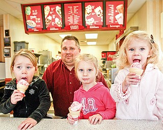 A lick for easter seals - Cameron Posta, 3, Manager of Freindlys in Poland - Tom Collins and sisters Carlie, 3, and Kaylie, 2, Harmon enjoy ice cream cones at Friendlys Ice Cream in Poland