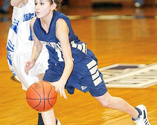 Emily Carson of Lowleville dribbles past Joey Courtney of McDonald.