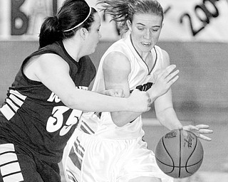 Lindsay Repp of McDonald drives past  Chelsie Marrie of Lowellville during 1-8-09 game.