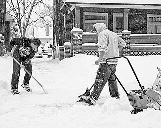 Chris Inskeep (18) of Hubbard and Ryan Foltz (25) of Hubbard shovel and plow Inskeep's grandmother's driveway in Youngstown, Saturday January 10, 2009