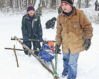 BOY SCOUT - (FRONT) Edward T. and Tim L. bring their sled up the hill Saturday afternoon.