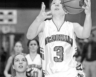 McDonald's Lindsay Repp shoots over Noel Amato of Wellsville during Thursday game at McDonald.