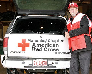 Steve Ilko of Boardman stands beside a Chevrolet Blazer that serves as an emergency relief vehicle.