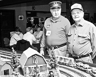 Jim Pope and Ray Lora of Salem stand inside McMenamy's Banquet Hall in Niles for the 2009 Winter Flea Market hosted by Youngstown Model Railroad Association,