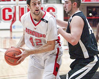 Dallas Blocker of YSU drives around Lambros Svingos of Geneva.