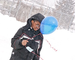 Anthony Dickerson holds a balloon to be released at Williamson Elementary in Youngstown, Tuesday January 20, 2009