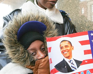 Beatrice Nelson and her son Rashaan Nelson 8, both of Youngstown,  make their way to the inauguration