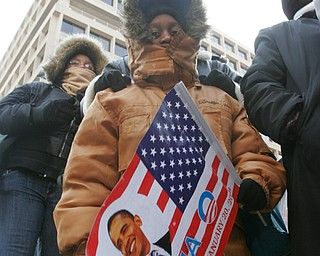 Rashaan Nelson, 8, of Y-town with an Obama poster during the inaugural events