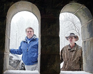 Mill Creek MetroParks' Pioneer Pavilion, built in 1821, is undergoing a restoration project. Above, Mark Fisher, left, Mill Creek MetroParks engineer, and Steve Avery, chief landscape architect, look through stone portals on the newly restored exterior stone steps at Pioneer Pavilion.