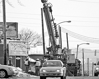 The road between Belle Vista and Millet avenues on the city's West Side was closed after a traffic accident at the 2000 block of Mahoning Avenue at 8:35 a.m. Friday. The accident caused downed power line wires to fall onto the road after a utility pole was struck, police said. Traffic was tied up for a couple of hours while Ohio Edison crews worked to replace the pole and wires.