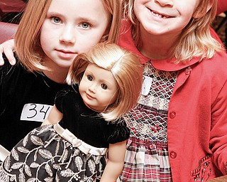 Kelley (or Sydney) Ferguson (7) and her friend Natalia Navicky (7) both of Austintown as they wait to audition for American Girl Fashion Show tryouts at St. Michael Church in Canfield, Sunday January 25, 2009