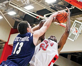 DeAndre Mays of YSU shots over Eric Buggs of Valpariso during Thusday's game.
