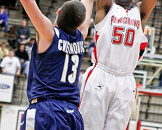 Jack Liles (50) takes a shot as Akron Nikola Cvetinovic (13) blocks at YSU Beeghly Hall, Monday January 26, 2009
