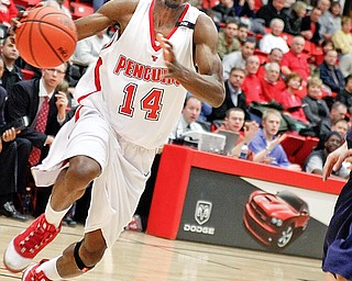 YSU Kelvin Bright (14) drives the ball to the basket at YSU Beeghly Hall against  Akron, Monday January 26, 2009