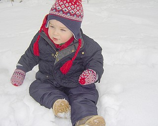 Frankie Rizzi, poses in the snow for his mom, Molly of Poland.