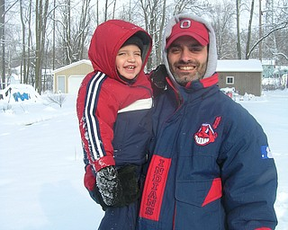 Gabriel Bettross, 23 months, and his dad Mike share a moment of winter.