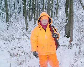 Caleb Johnson, 9, a student at Roosevelt Elementary in Hubbard, treks though the snowy woods with his grandfather, Jim McCullough, on his 