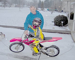 Kevin tests out his dirt bike with Granpa Bill Valentino.