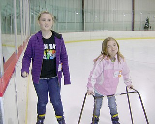 Lauren Hall, 11, and sister Emily, 7, wanted snow, but had to settle for a cool skate at the Ice Zone in Boardman when they visited relatives here  over the Christmas holidays. They live in Houston, Texas.