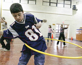 Tyler Dietz - third grader - at Stadium Drive Elementary  - participate in the hula hoop exercise - students shot baskets jumped rope and did the hula hoop for sponsors - to raise money - for the Heart Association - robertkyosay