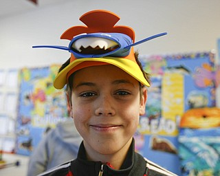 Avery Fisher a fourth grader donned his shark hat as Right to Read week activities got underway at Robinhood Elementary in Boardman