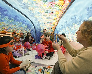 IN THE BUBBLE -  Reading specialist reads to third graders in side the bubble telling them about undersea creatures and life - as Right to Read week activities got underway at Robinhood Elementary in Boardman -