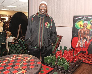 """Professor Peacock (49) of Columbus stated that in chess """"white moves first -so its subliminally racist."""" Playing chess has been proven to improve test scores, so he crafts chess board tables and pieces to encourage youth to learn strategies instead of participating in gangs. YSU's African Marketplace for Black History Month in the Chestnut room at Kilcawley Center, Saturday February 7, 2009  ** If you also want to diminish youth violence, You may contact him at testscorerise@yahoo.com"""