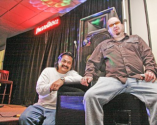 Funny Farm Comedy Club Entertainment Director Eric Stevens and Proprietor Chris Jackson next to the stage