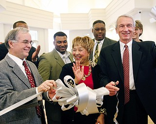 Millicent Counts (center) applauds as Carlton A. Sears and Dr. David Ritchie cut the ribbon. Behind them are Mayor Jay WIlliams (not seen) 2nd Ward Councilman DeMaine Kitchen and former Councilman Rufus Hudson at the ribbon cutting of the new East Side Library.