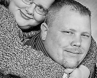 Lisa M. Brewer and Michael J. Kuty